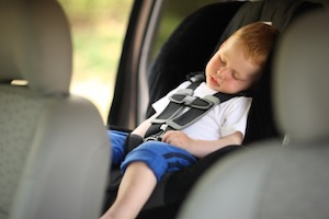Child sleeping on car seat