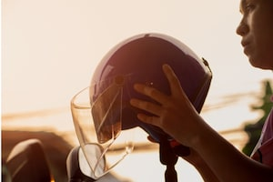 Motorcyclist and helmet