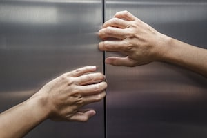 Person trying to open elevator door